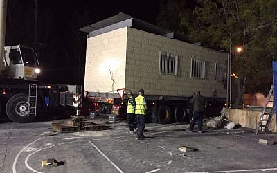 The Defense Ministry delivers a series of trailers to the Givat Ze'ev settlement on Nov. 16, 2015. The structures will serve as a temporary replacement for an illegally built synagogue, which is slated for demolition, until a permanent building can be constructed. (Defense Ministry's Operations Department)