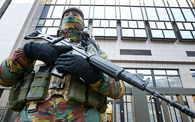 A Belgian police officer guards the building of the European Commission in Brussels, Belgium, Tuesday, Nov. 24, 2015. (AP Photo/Michael Probst)