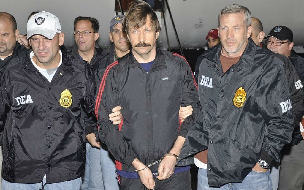 Suspected Russian arms dealer Viktor Bout (center) is escorted by US Drug Enforcement Administration (DEA) officers after arriving in New York, November 16, 2010. (Courtesy of DEA)