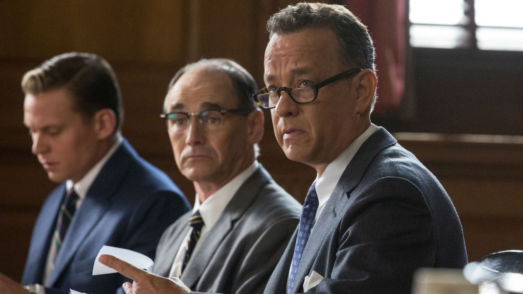 In this image released by Disney, Tom Hanks, from right, Mark Rylance and Billy Magnusson appear in a scene from the film, 'Bridge of Spies.' (Jaap Buitendijk/DreamWorks Pictures/Fox 2000 Pictures via AP)