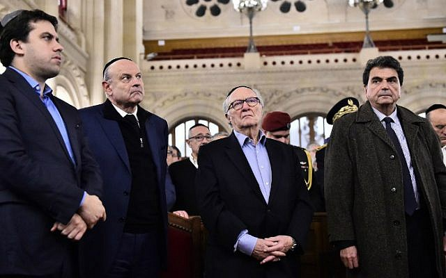 French righ-wing party UMP national delegate Pierre Lelouche (right) and French Jewish Institutions Representative Council (Conseil Representatif des Institutions juives de France - CRIF) President Roger Cukierman (2nd from right) and French junior minister for Parliamentary Relations Jean-Marie Le Guen (2nd from left) attend a ceremony for the victims of a series of deadly attacks at the Grande synagogue de la Victoire on November 15, 2015. (AFP / Loic Venance)