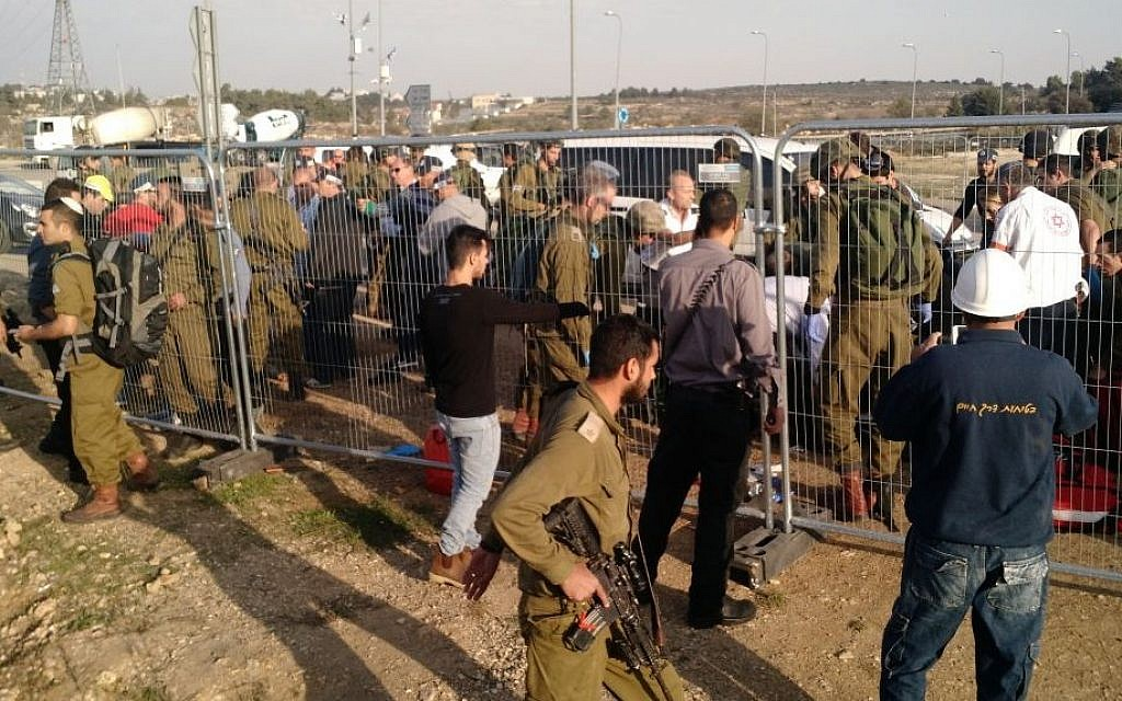 Soldiers respond to the scene of a stabbing terror attack at the Gush Etzion Junction on Sunday, November 22, 2015. (Judah Ari Gross/Times of Israel)