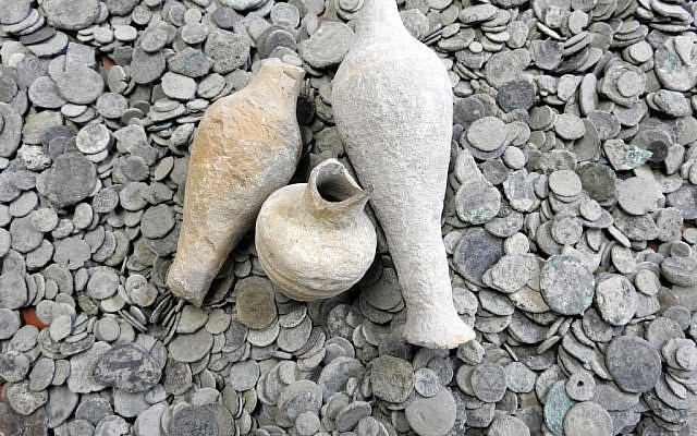 Ancient coins and jars confiscated from an antiquities dealer in northern Israel suspected of illegal sale of artifacts on November 24, 2015. (Israel Antiquities Authority)