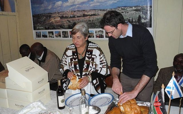 "Barbara Steenstrup, the editor of ""Shelanu,"" the newsletter of the Nairobi Hebrew Congregation, visited a community of 1,500 self-identified Jews in Nyahruru. The elders were thrilled to try challah, purchased from Israeil-owned Artcafe, the Kenyan knockoff of Arcafe. (courtesy Barbara Steenstrup/Nairobi Hebrew Congregation)"