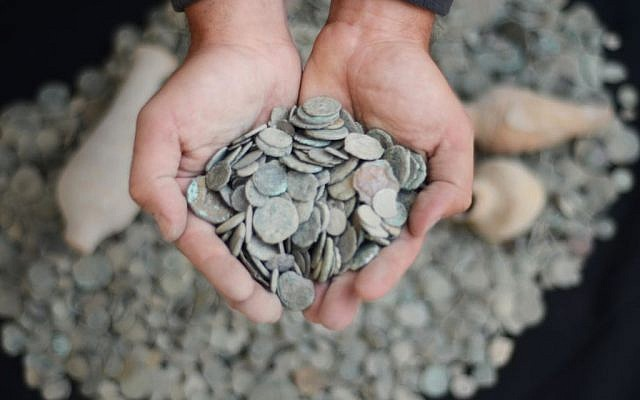 Ancient coins confiscated from an antiquities dealer in northern Israel suspected of illegal sale of artifacts on November 24, 2015. (Israel Antiquities Authority)
