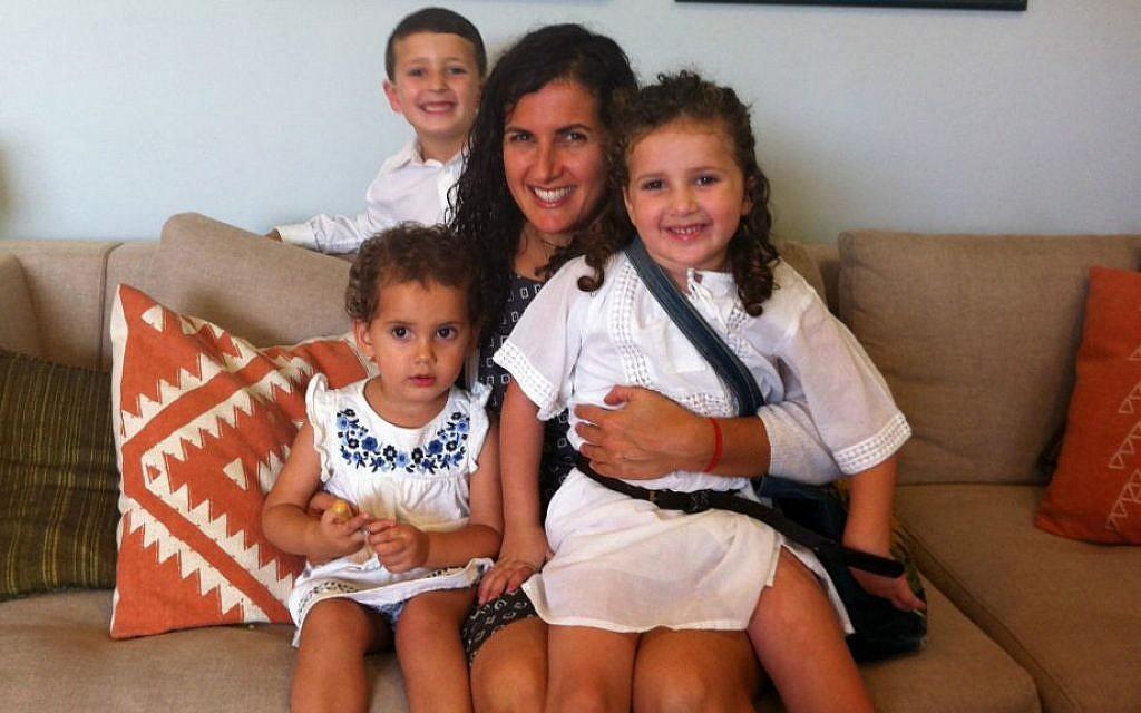 Spiritual parenting expert Dasee Berkowitz and her three children in their Jerusalem home. (courtesy)