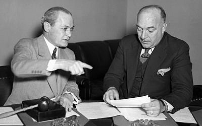 Chairman Samuel Dickstein, left, of the House Immigration Committee, discussing the bill of Rep. William Schulte, D-Ind., to restrict immigration into the United States from Mexico, March 7, 1934. (AP Images, via JTA)