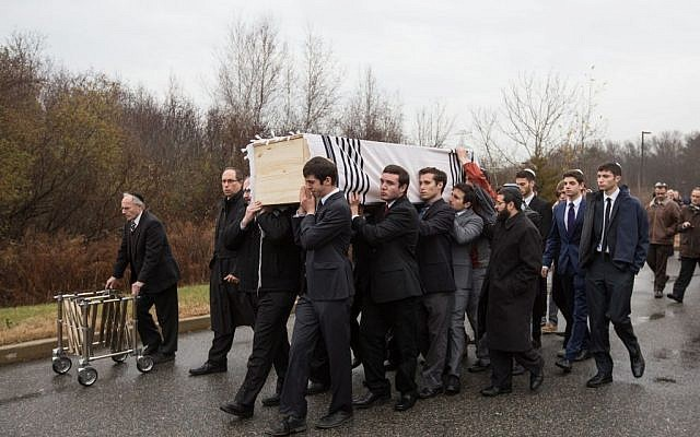 Following the funeral of Ezra Schwartz, 18, an American yeshiva student who was murdered in a Palestinian terror attack in Israel in mid-November, friends carry the slain teen's casket outside Temple Sinai in Sharon, Massachusetts on November 22, 2015. (Elan Kawesch/The Times of Israel)