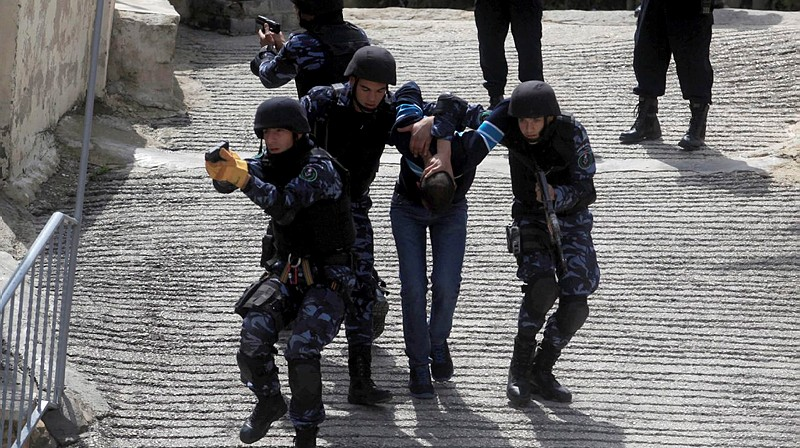 Illustrative: Palestinian police take part in a training session of the Palestinian special police force in the West Bank city of Ramallah in 2014. (Issam Rimawi/Flash90)