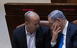 Prime Minister Benjamin Netanyahu, right, with Education Minister Naftali Bennett in the Knesset, June 17, 2015. (Miriam Alster/Flash90)