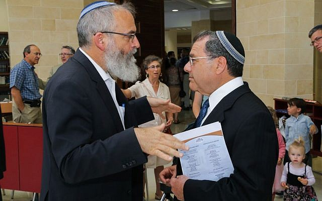 Rabbi David Stav of Shoham talks to Rabbi Shlomo Riskin of Efrat, July 2, 2015. (Gershon Elinson/Flash90)