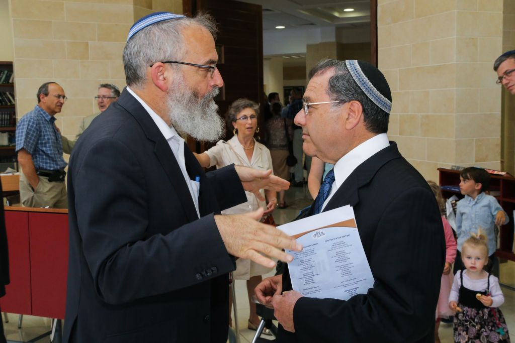 Rabbi Shlomo Riskin of Efrat (right) speaks with Rabbi David Stav of Shoham on July 2, 2015. Riskin and Stav are part of a group of leading rabbis who decided to establish independent conversion courts in Israel. (Gershon Elinson/Flash90)