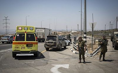 An ambulance at the scene of a stabbing attack on Route 443 on August 15, 2015. (Hadas Parush/Flash90)