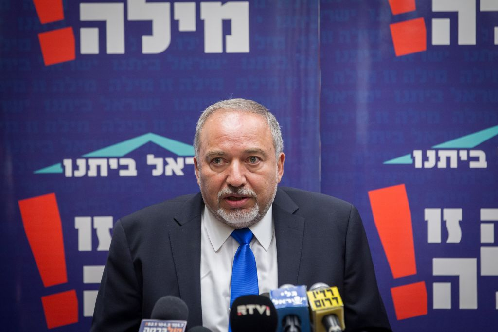 Head of the Yisrael Beytenu party Member of Knesset Avigdor Liberman leads a party meeting in the Knesset, October 19, 2015. (Miriam Alster/Flash90)