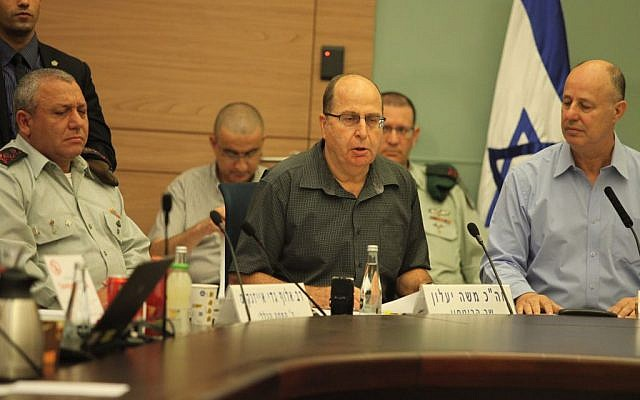 Defense Minister Moshe Ya'alon speaks to the Knesset's Foreign Affairs and Defense Committee on November 3, 2015. He is flanked by committee chair Tzachi Hanegbi and IDF Chief of Staff Gadi Eisenkot. (Issac Harari/Flash90)