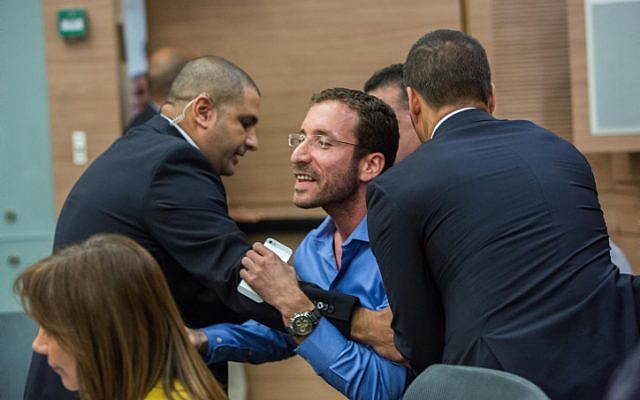 Israeli parliament member Itzik Shmuli is escorted out from a debate regarding the Israeli Jewish anti-assimilation 'Lehava' organization at the Interior Affairs committee meeting in the Knesset on November 10, 2015. (Yonatan Sindel/FLASH90 )