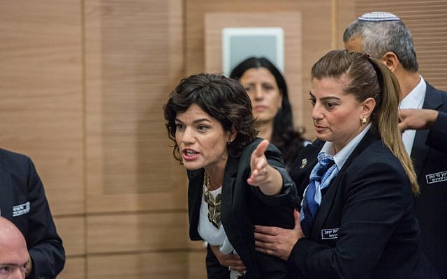 "Meretz MK Tamar Zandberg is escorted out from a debate regarding the Israeli Jewish anti-assimilation ""Lehava"" organization at an Interior Affairs committee meeting in the Israeli parliament on November 10, 2015.(Yonatan Sindel/FLASH90)"