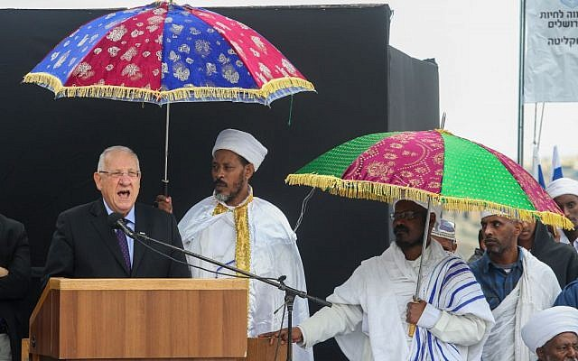 President Reuven Rivlin, left. speaks during a mass prayer of the Sigd holiday attended by hundreds of Ethiopian Jews, at the Sherover Promenade overlooking the Old City of Jerusalem, November 11, 2015. (Flash90)