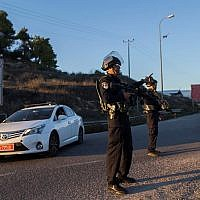 Illustrative: Israeli security police stand near the Otniel Junction in the southern West Bank on November 13, 2015. (Yonatan SIndel/Flash90)