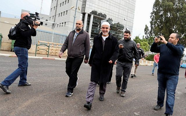 Sheikh Raed Salah, leader of the Northern Branch of the Islamic Movement in Israel, walks away after speaking to the media following the security cabinet's decision to outlaw the movement. (November 17, 2015)
