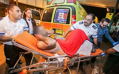 Medical personnel rush an Israeli man to the emergency unit at Barzilai Hospital in Ashkelon after he was wounded in a stabbing attack in the southern Israeli city of Kiryat Gat, on November 21, 2015. (Edi Israel/Flash90)