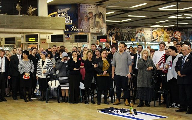Friends and family attend a ceremony in memory of Ezra Schwartz at Ben Gurion international airport on Saturday night, November 21, 2015 (Moti Karelitz/ZAKA TEL AVIV)