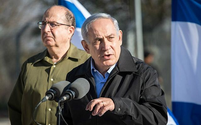 Prime Minister Benjamin Netanyahu (R) and Minister of Defense Moshe Ya'alon at the Etzion Bloc in the West Bank on November 23, 2015. (Emil Salman/Haaretz/Pool)