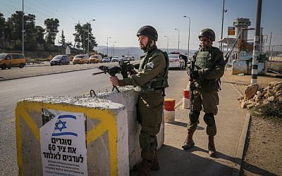 Israeli soldiers stand guard at the Gush Etzion Junction, an area which has been hit by several terror attacks in the past weeks, on November 23, 2015. (Gershon Elinson/Flash90)