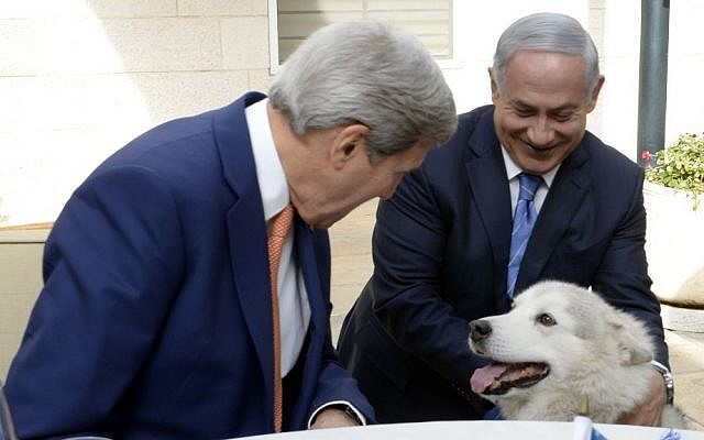 US Secretary of State John Kerry pets Kaia, the dog of Prime Minister Benjamin Netanyahu, as Kerry and Netanyahu meet at the PM's official residence in Jerusalem, on November 24, 2015. (Matty Stern/US Embassy Tel Aviv)