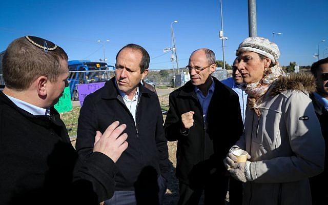 Jerusalem Mayor Nir Barkat, second left, Etzion Bloc Regional Council leader Davidi Perl, second right, and other local politicians discuss security measures at Etzion Junction in the West Bank, south of Jerusalem on November 24, 2015. (Gershon Elinson/FLASH90)