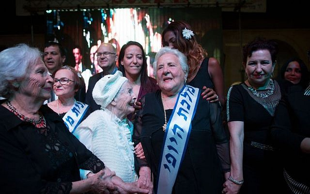 Holocaust survivor Rita Berkowitz, 83 celebrates winning a Holocaust survivors beauty pageant in Haifa on November 24, 2015. (Yonatan Sindel/Flash90)