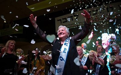 Holocaust survivor Rita Berkowitz, 83 celebrates winning a Holocaust survivors beauty pageant in Haifa on November 24, 2015. (Yonatan Sindel/Flash90)
