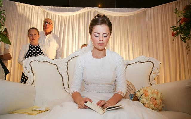 Sarah Litman, the daughter and sister of terror victims Ya'akov Litman and Netanel Litman, on her wedding day, November 25, 2015 in Jerusalem.  Her father and brother were killed on November 13 in shooting attack in the West Bank. (Hadas Parush/Flash90)