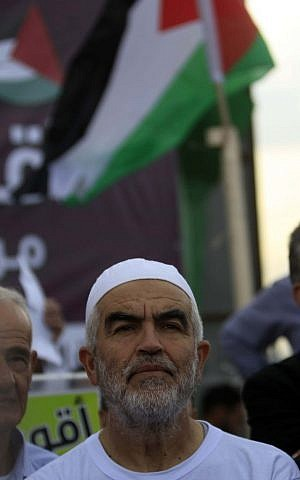 Leader of the Northern Branch of the Islamic Movement in Israel, Sheikh Raed Salah, seen during a demonstration with his supporters against Israel's recent decision to outlaw the Northern Branch, on November 28, 2015, in Umm el Fahm, northern Israel. Salah was recently sentenced to eleven months in prison for incitement to violence and racism against Jews. (Photo by Muammar Awad/Flash90)