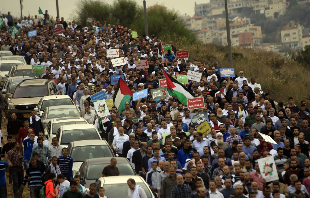 Thousands of supporters of the Islamic Movement in Israel, and its Northern Branch leader, Sheikh Raed Salah, demonstrate against Israel's recent decision to outlaw the Northern Branch, on November 28, 2015, in Umm el Fahem, northern Israel. (Photo by Muammar Awad/Flash90)