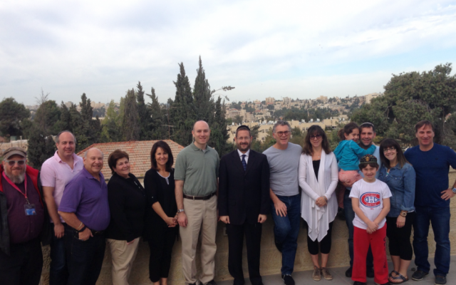 Former MK Dov Lipman with Rabbi Fishman and his flock in Jerusalem