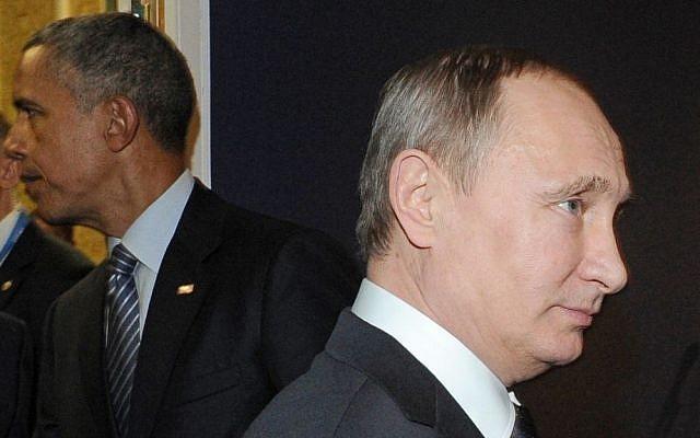 Russian President Vladimir Putin and US President Barack Obama attend the UN climate change conference in Paris, France, on November 30, 2015. (Mikhail Klimentyev/Sputnik, Kremlin Pool Photo via AP)