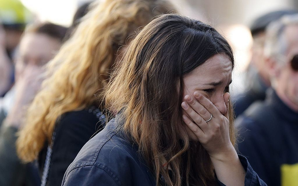 A woman cries outside the restaurant on Rue de Charonne, Paris, Sunday, Nov. 15, 2015, where attacks took place on Friday. (AP/Frank Augstein)