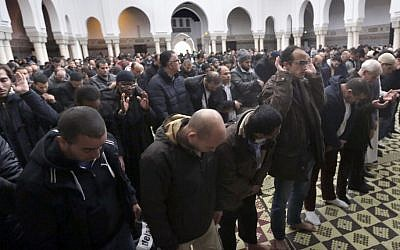 People pray during the Friday prayer at a Paris mosque, November 20, 2015. (AP/Amr Nabil)