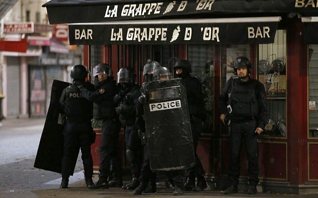 Police forces prepare in Saint Denis, a northern suburb of Paris, Wednesday, Nov. 18, 2015 (AP Photo/Francois Mori)