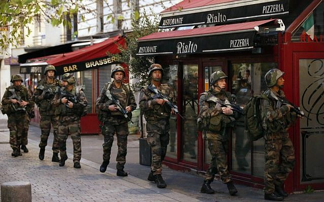 Soldiers operate in St. Denis, a northern suburb of Paris, Wednesday, Nov. 18, 2015 (AP Photo/Francois Mori)