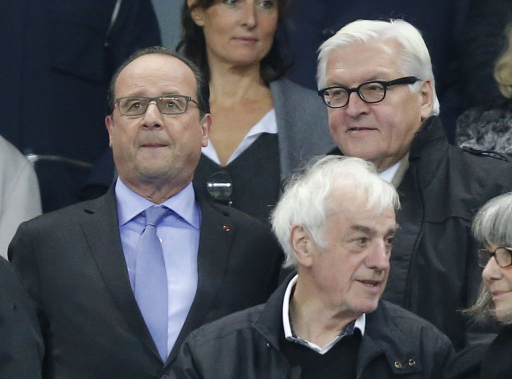 French President Francois Hollande, left, and German Foreign Minister Frank-Walter Steinmeier watch the international friendly soccer match France against Germany at the Stade de France stadium in Saint Denis, outside Paris, Friday Nov. 13, 2015. (AP Photo/Michel Euler)