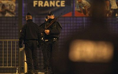 Police officers stand guard outside the Stade de France stadium after an explosion and after international friendly soccer match France against Germany, in Saint Denis, outside Paris, early Saturday November 14, 2015. (AP Photo/Michel Spingler)