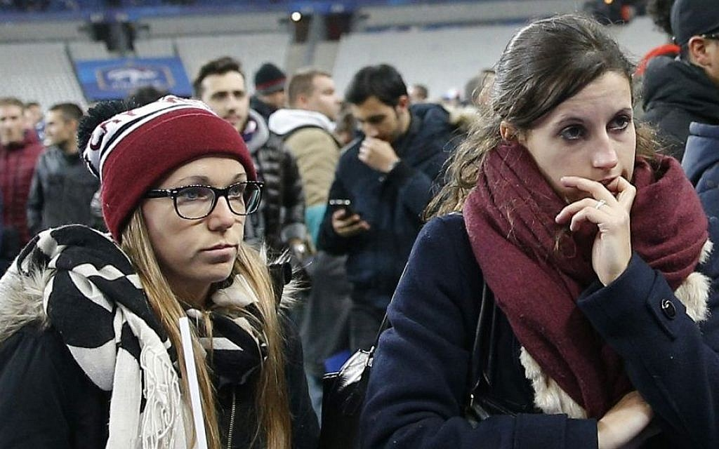 Soccer fans wait on the fitch of the Stade de France stadium after an international friendly soccer match in Saint Denis, outside Paris, Friday, Nov. 13, 2015. (AP/Christophe Ena)