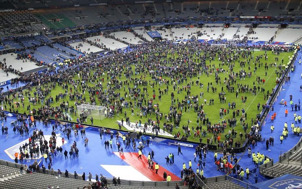 Spectators invade the pitch of the Stade de France stadium after two explosions went off near the international friendly soccer France against Germany, Friday, November 13, 2015. (Photo by AP Photo/Michel Euler)