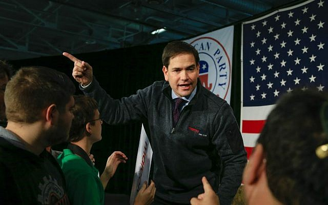 Republican presidential candidate Sen. Marco Rubio, R-Florida, talks to supporters after speaking at the Iowa GOP's Growth and Opportunity Party at the Iowa state fair grounds in Des Moines, Iowa, Saturday, Oct. 31, 2015. (AP Photo/Nati Harnik)