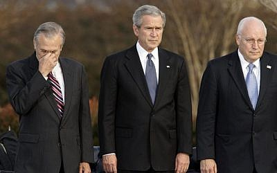 In this Friday, Dec. 15, 2006, file photo, Secretary of Defense Donald Rumsfeld, left, pauses as President George W. Bush, and Vice President Dick Cheney participate in Rumsfeld's farewell ceremony at the Pentagon in Washington. (AP Photo/J. Scott Applewhite, File)