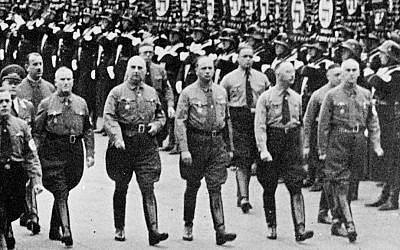 In this 1938 file photo Heinrich Himmler, second right, chief of secret police, and Dr. Wilhelm Frick, right, and other leading members of the Nazi party march along Koenigliche Platz in Munich, southern Germany. (AP Photo/file)
