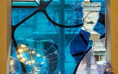 A smashed window photographed in the synagogue in Cottbus, eastern Germany, Wednesday November 18, 2015. (Patrick Pleul/dpa via AP)