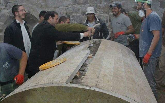 Repairs are carried out at Joseph's Tomb on the outskirts of Nablus, overnight November 2, 2015. (Meir Brachia)